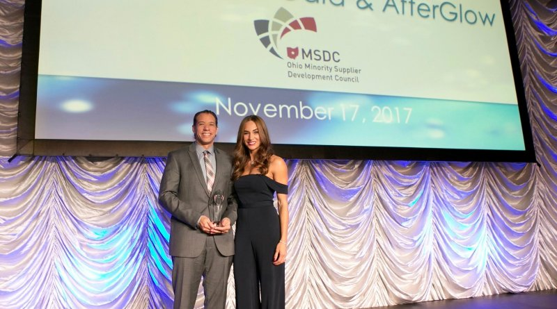 E.E. Ward Moving & Storage co-owners Dominique and Brian Brooks accept the Minority Business Enterprise (MBE) Supplier of the Year Award (Class II) at the Ohio Minority Supplier Development Council (OMSDC) Annual Awards Gala on November 17. (PRNewsfoto/North American Van Lines,E.E. W)